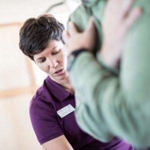 An OSD Healthcare physiotherapist guiding a patient through an exercise
